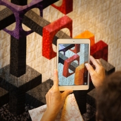 taking a picture of a quilt A45X8481