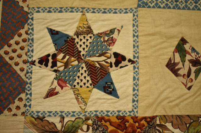 62.43 Patchwork bedcover Anne Pritchard close-up small rayed sun compressed