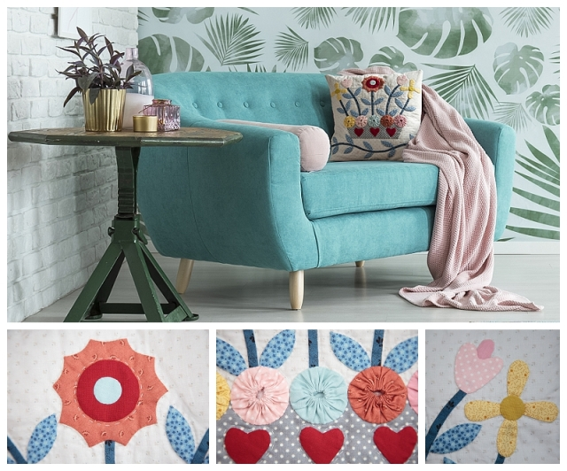 Turquoise sofa against floral wallpaper