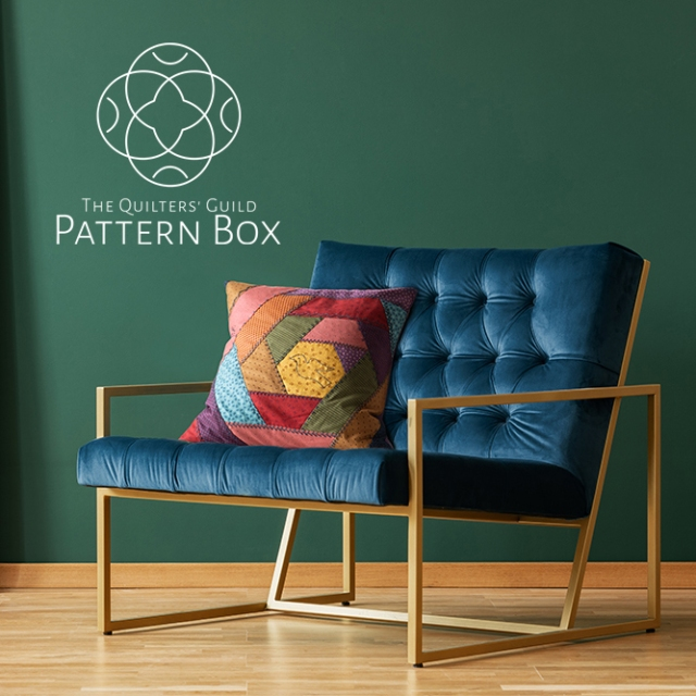 Brown cushion on blue armchair in green living room interior wit