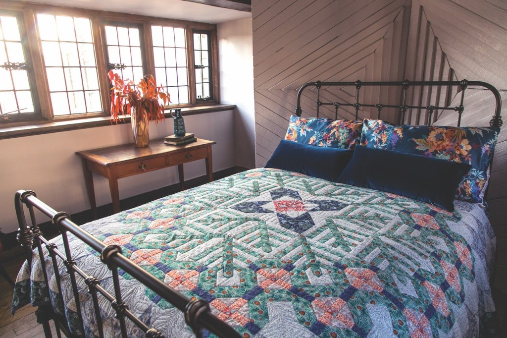 Liberty quilt by Jenni Smith on a bed in a historic home.